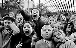 Alfred Eisenstaedt's 1963 photograph of children watching a puppet show in the Tuilieries